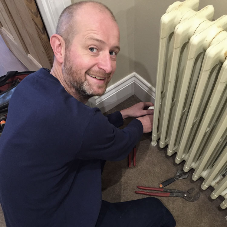 Matthew Scanlon Plumbing and Heating fitting a radiator