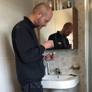 Matthew Scanlon Plumbing and Heating fixing a sink